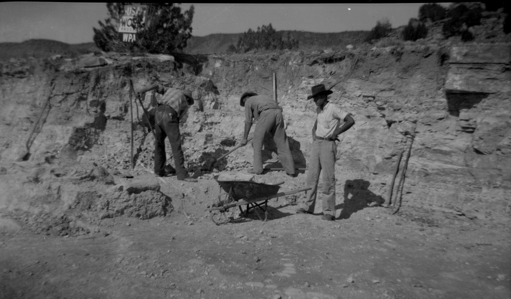 Workers in the field under WPA sign